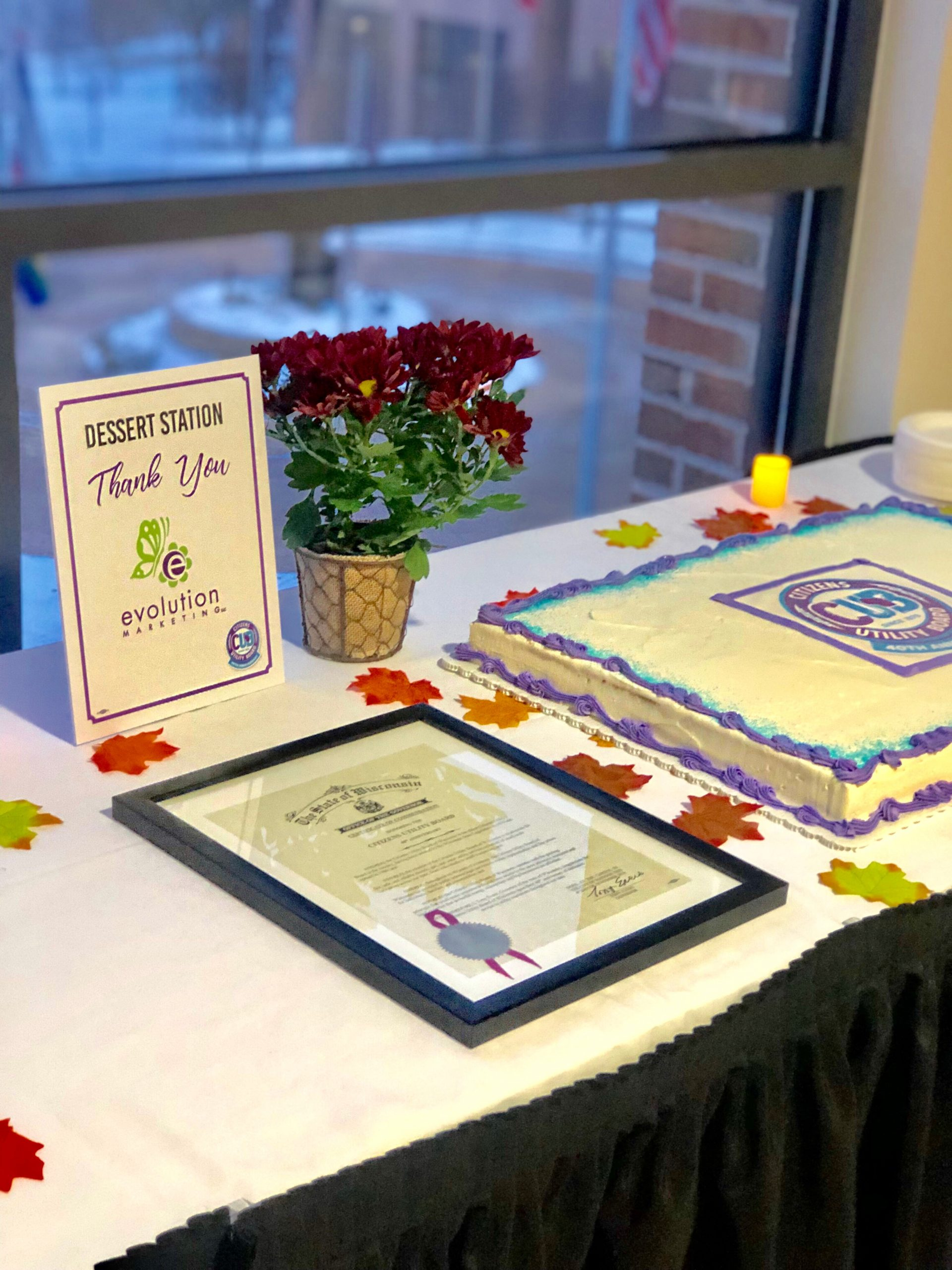 Commendation from Gov. Evers and 40th cake at 40th celebration at American Family Insurance